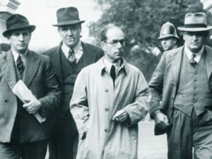 Antonio Agostini being escorted into court.
