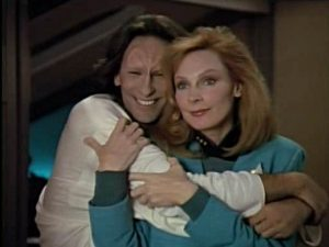 The Trill Odan, hugging a very happy Dr Beverley Crusher
