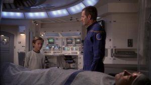 Captain Archer shows a comatose Trip to a teenage Sim