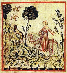 Medieval illustration of man hunting on horeback with hawk and dog